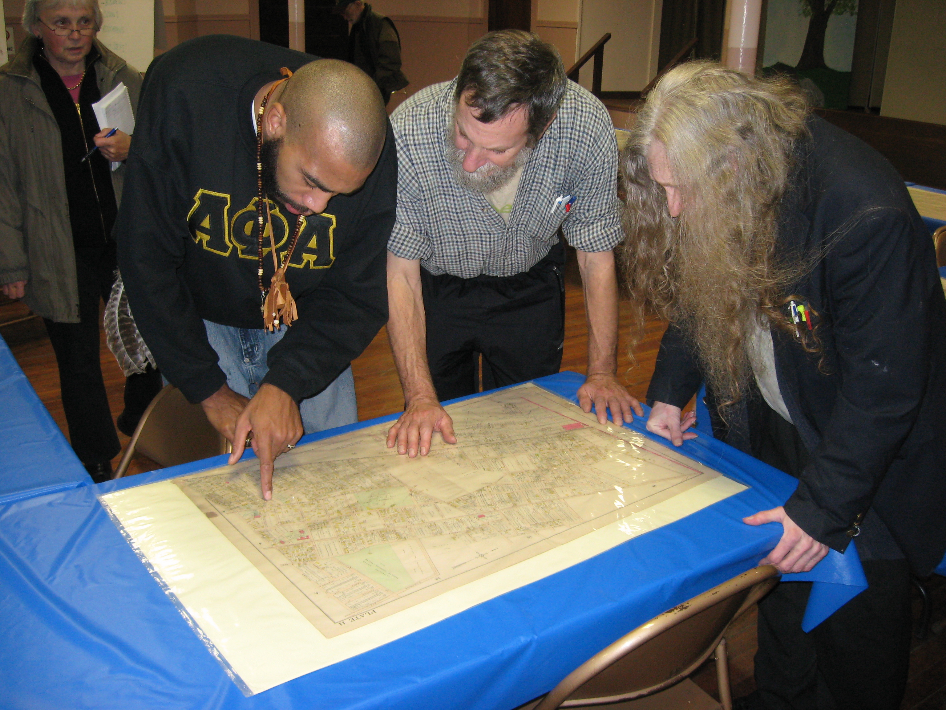 Ray Watson, Greg Gerritt and David Kolsky find their bearings on an insurance map from the early 20th century.