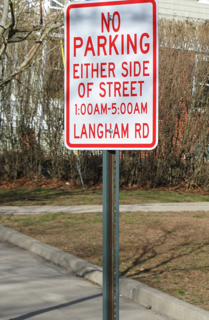 The city has started posting signs that prohibit overnight parking on streets where residents have opted out of the city-wide plan.