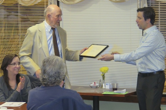 SNA President Dean Weinberg, right, awards a certificate of recognition to community activist Gil Mason.