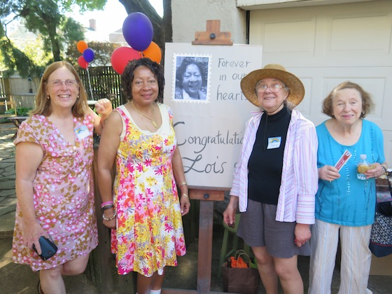 Lois J. Overton Wortham and friends gather at the sign expressing the feeling of her constituents.