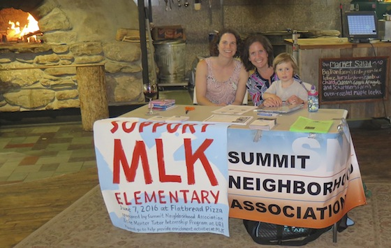 SNA activists, from left, Shanna Pearson, Emily Spitzman and son Emmett Waugh staff an information table at Flatbread Pizza.