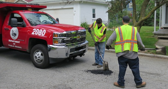 A crew from the Providence Department of Public Works fills some potholes on Bayard Street. A worker said they have scouts out looking for spots that need repairs or they respond to called-in locations.