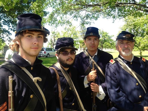 Met High School student re-enactors of the 14th Rhode Island Regiment of Heavy Artillery, directed by Rob Goldman, led a memorial march.