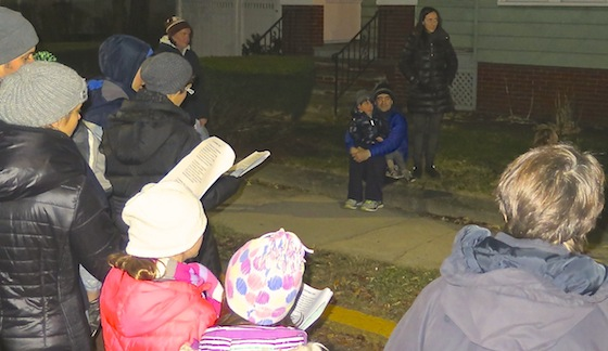 One family came out onto their lawn to enjoy the songs.