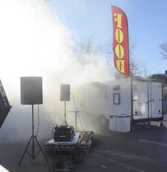 The same banner flies above the smoke after the food truck caught fire and onlookers feared the propane tanks inside would explode. They didn't and the fire department got everything under control.