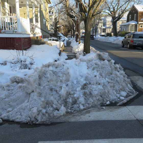 Summit residents shoveled their sidewalks to the streets, but then the snowplows returned.