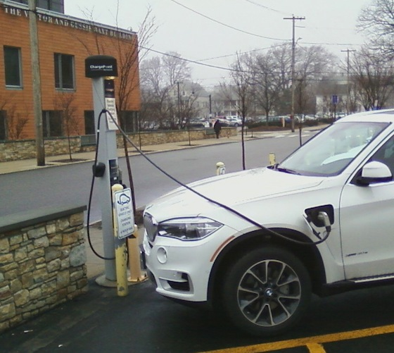 A vehicle in Miriam Hospital's parking lot on Summit Avenue gets a shot from the charging station. Many patients have gotten similar treatment from the hospital