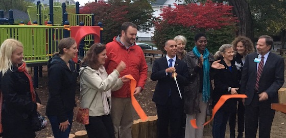 The reopening ribbon flies after being cut by Mayor Jorge Elorza. Cheering him on are from left: Monica Anderson, Miriam Hospital; Amy Martinez, Friends of Summit Avenue Park; Nancy Buron, Summit Neighborhood Community Gardens; Ethan Gyles, SNA; Wendy Nilsson, Parks Department; Nirva LaFortune, Ward Three councilwoman; Meghan Gardner, city landscape architect; Helene Miller, Partnership for PVD Parks; Arthur Sampson, Miriam Hospital.