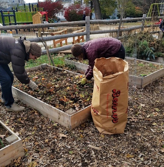 Jessica and Read Porter clean out their plot.